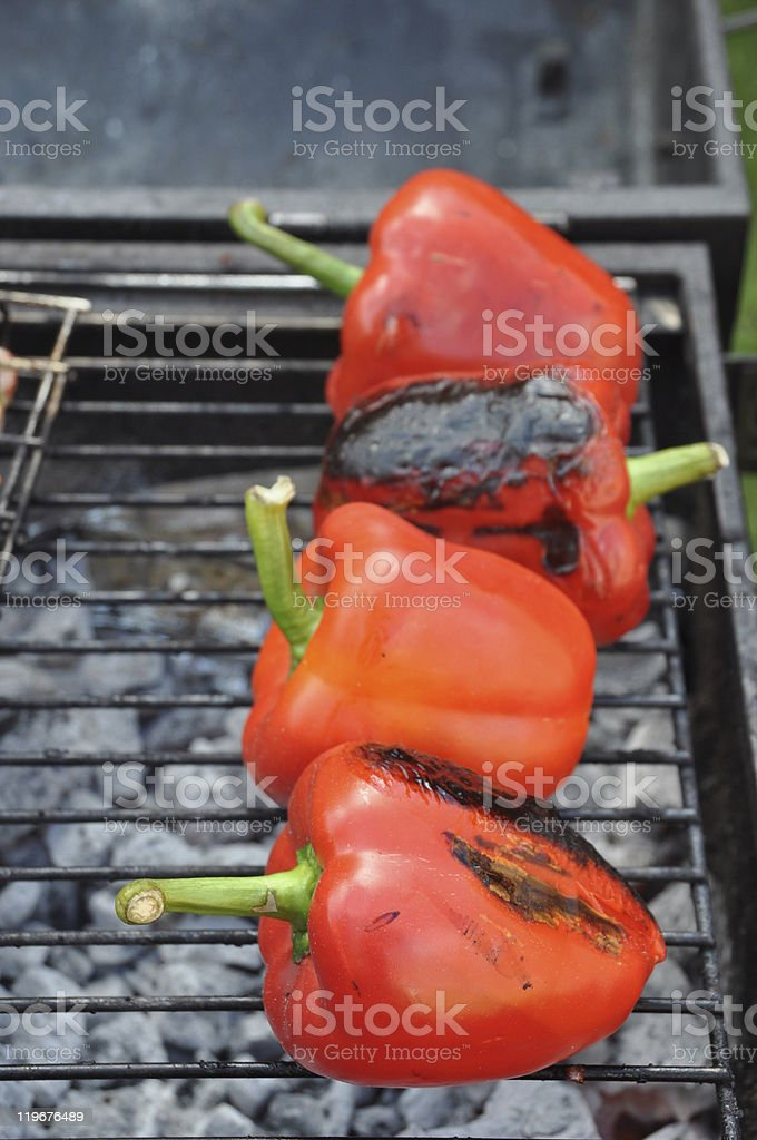 Grilling red peppers royalty-free stock photo