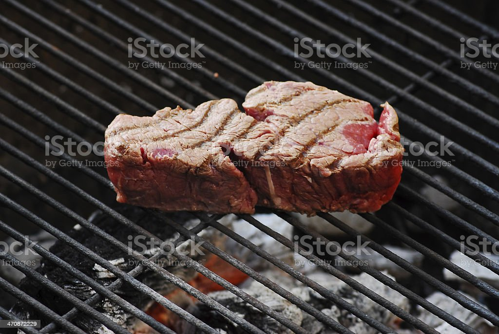 Grilling steaks royalty-free stock photo