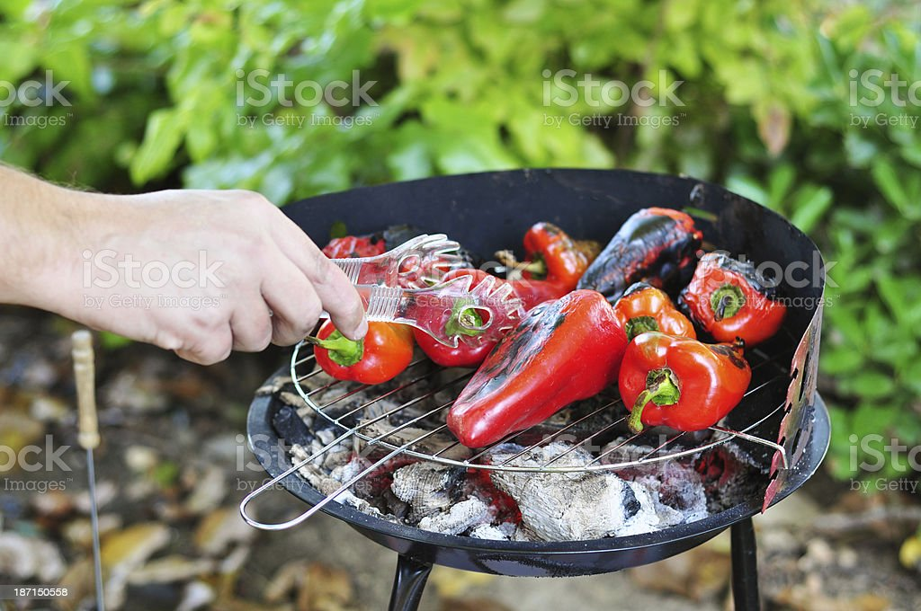 Grilling the red peppers royalty-free stock photo
