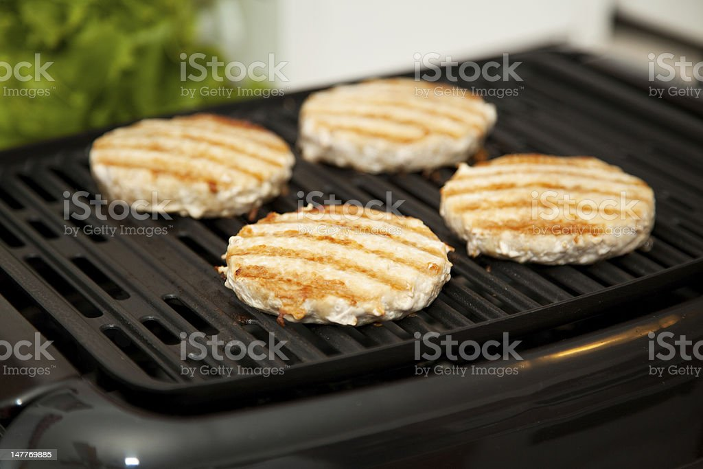 Grilling Turkey Burgers stock photo