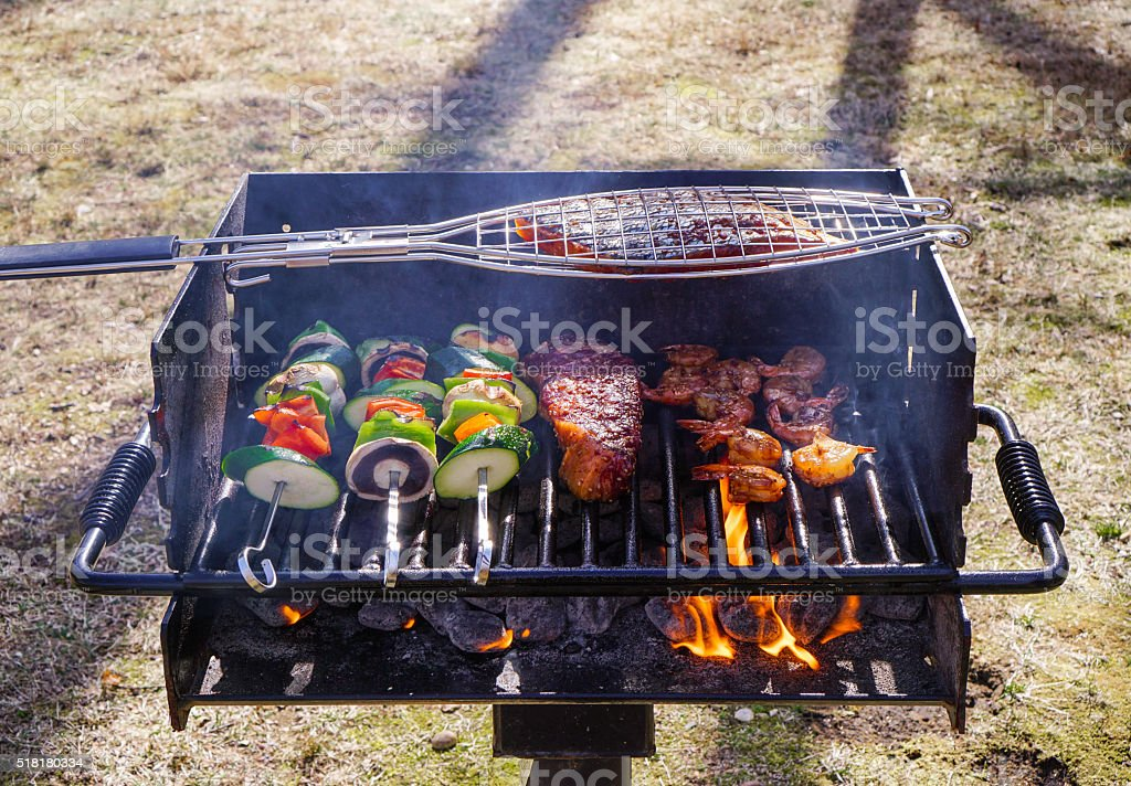 Grilling vegetables, steak, salmon,shrimps outdoor. stock photo