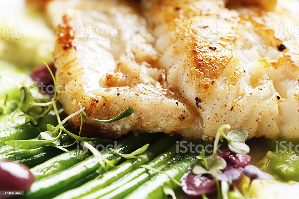 Grillled white fish with green beans: healthy, low-carb, and delicious stock photo