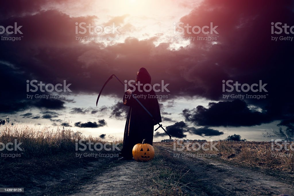 Grim Reaper and Jack O' Lantern stock photo