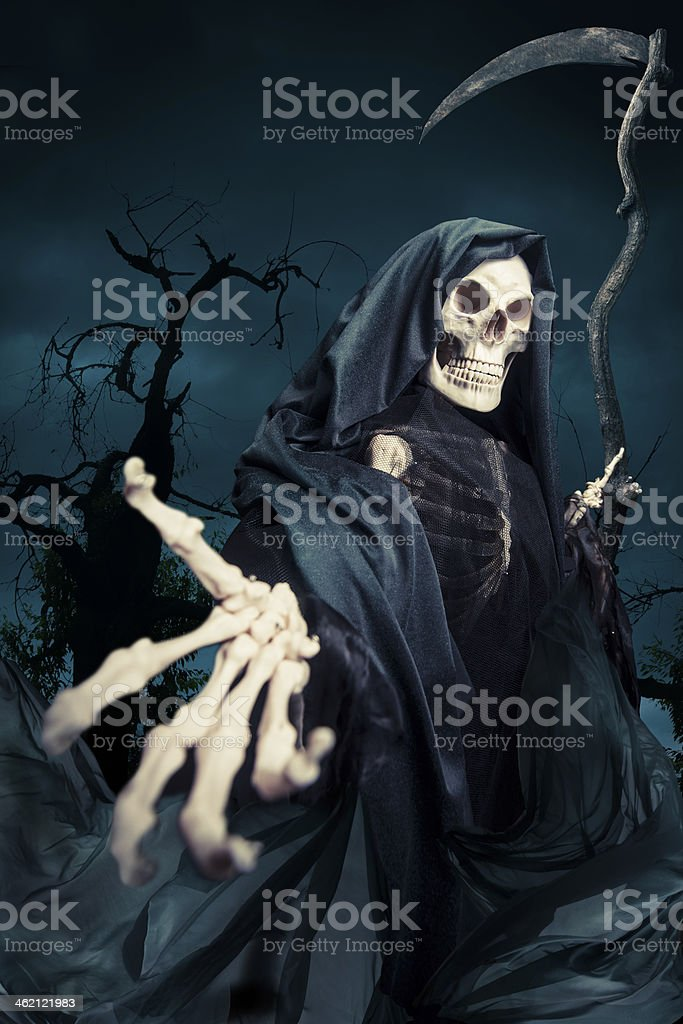 Grim reaper/ angel of death at night stock photo