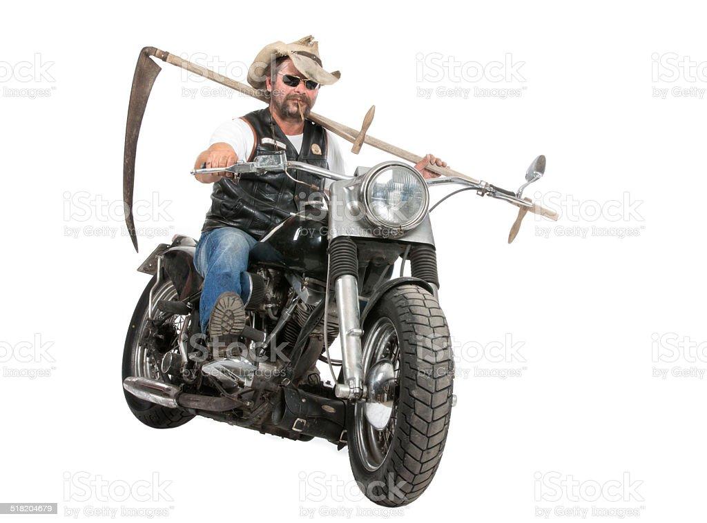 Grim Reaper comes on motorbike stock photo