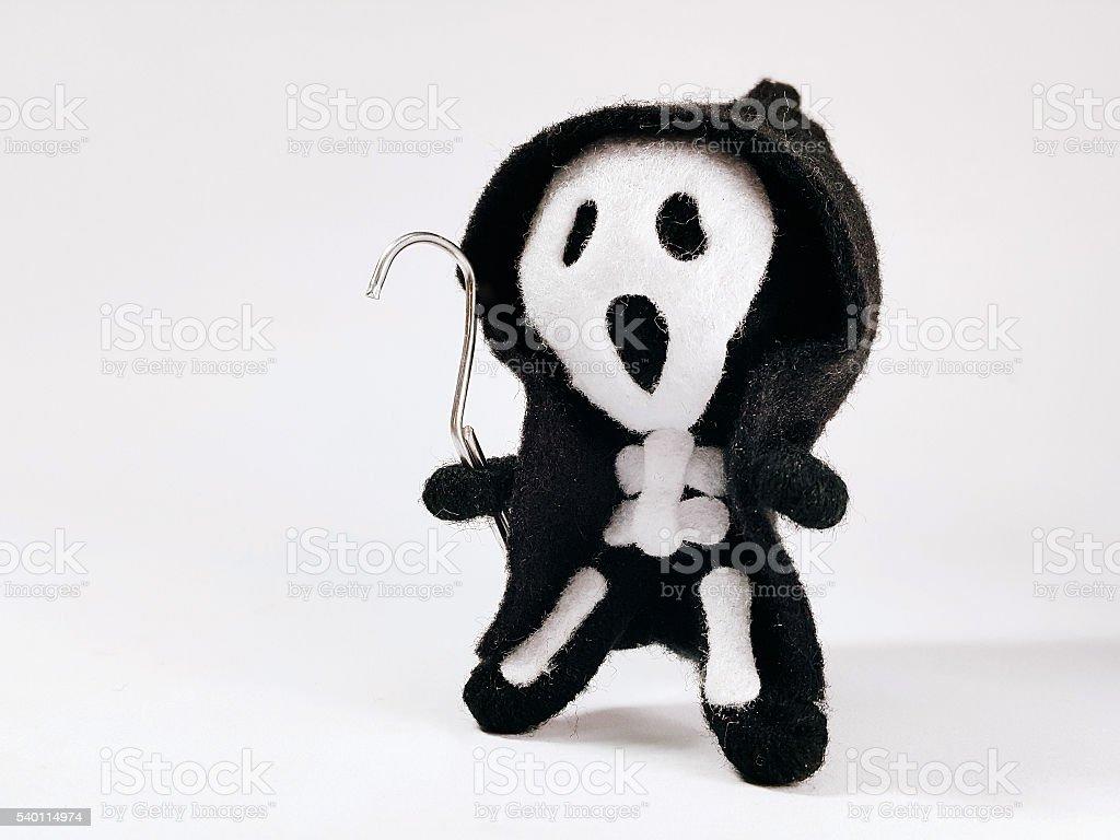 Grim Reaper felt rag doll with clothing stock photo
