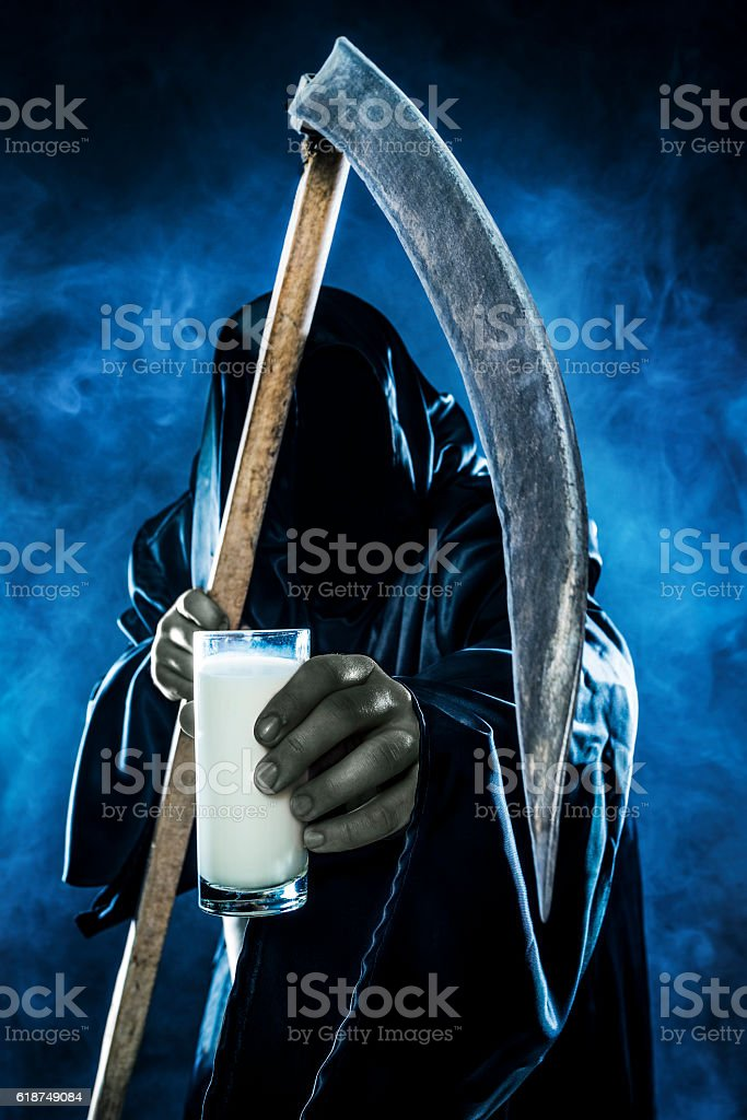 Grim reaper holding milk stock photo