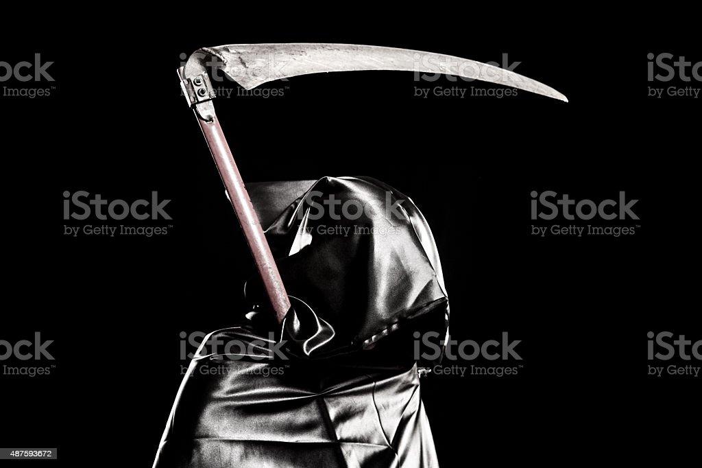 Grim Reaper portrait on black background stock photo