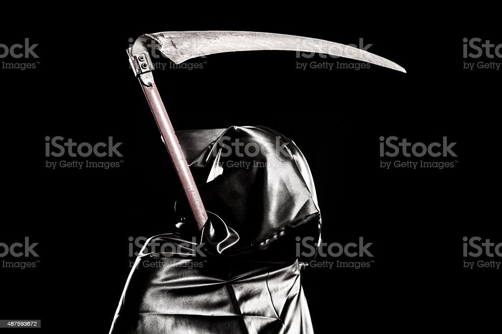 Grim Reaper portrait on black background stock photo
