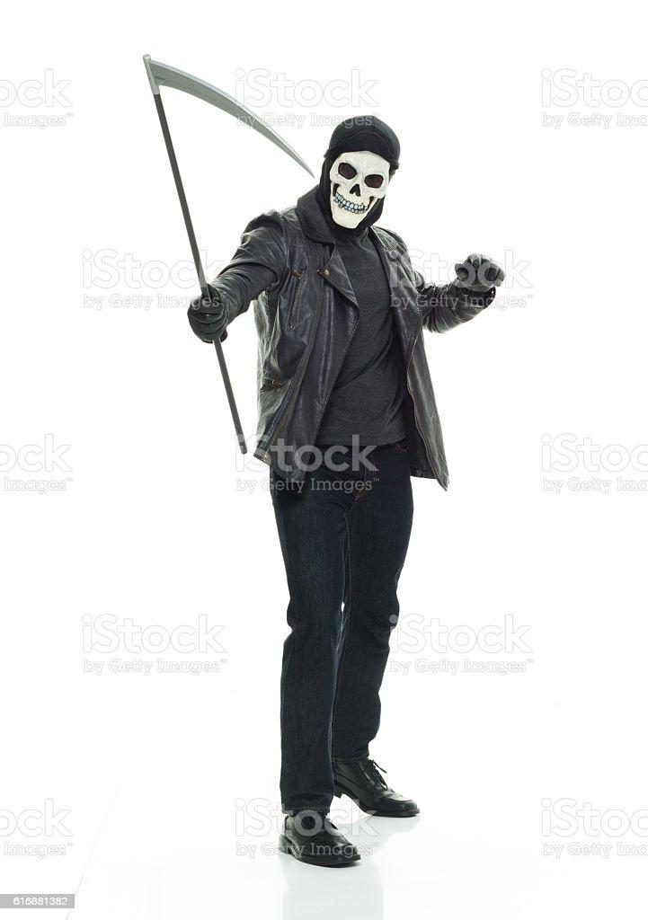 Grim reaper posing with scythe stock photo