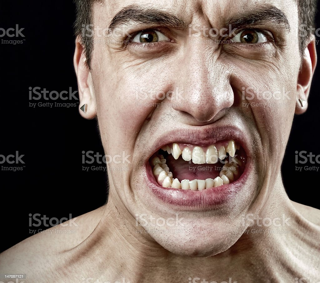 Grimace of angry furious stressed man royalty-free stock photo