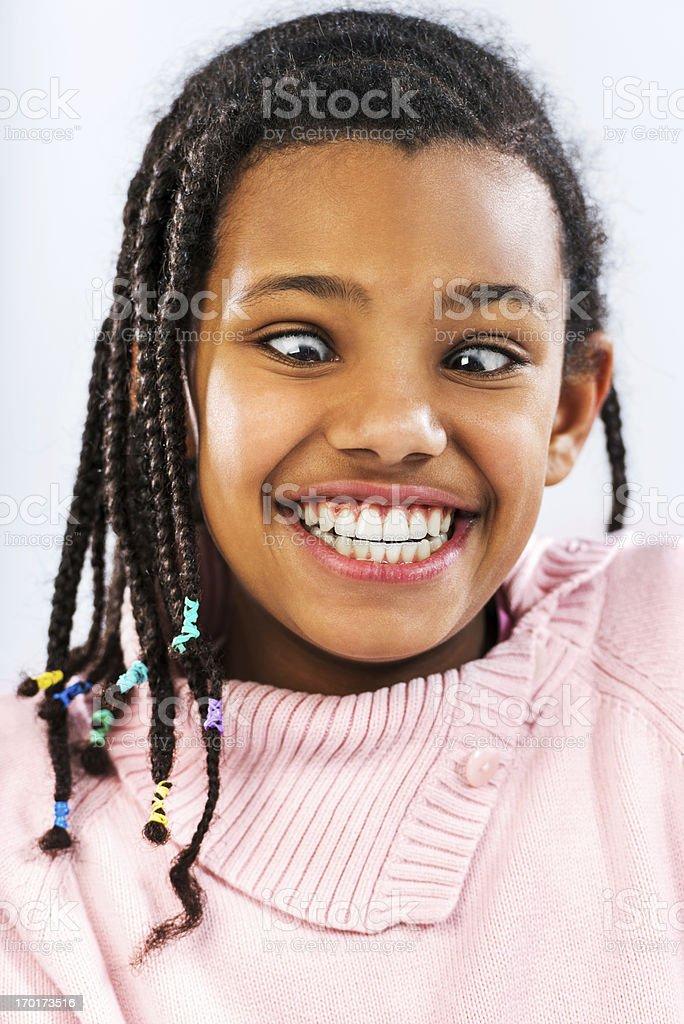 Grimacing African-American little girl. royalty-free stock photo