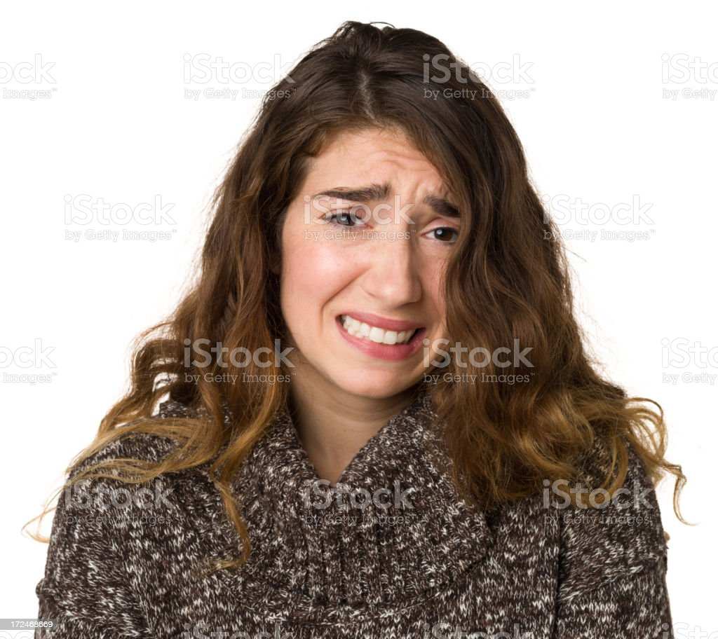 Grimacing Worried Young Woman royalty-free stock photo