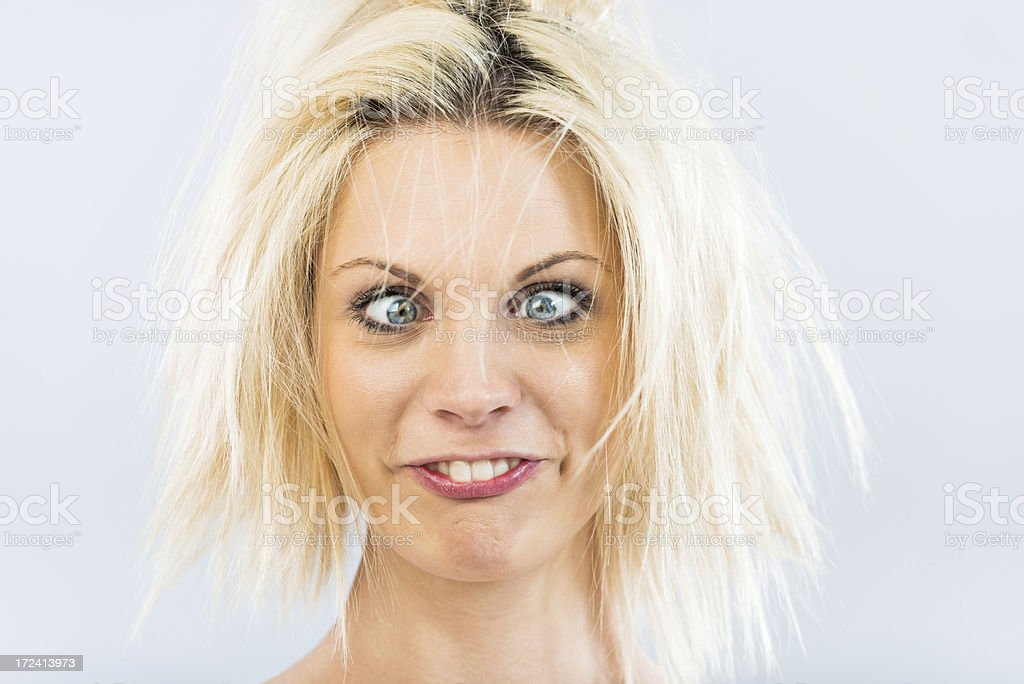 Grimacing young woman royalty-free stock photo