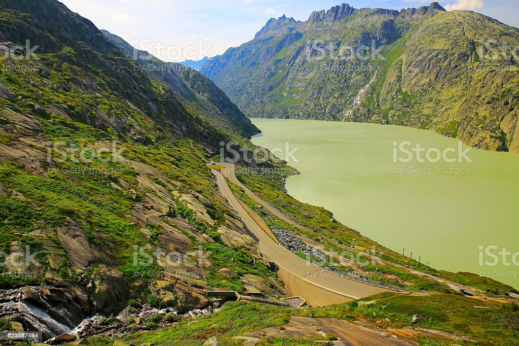 Grimsel pass landscape, glacier lake reservoir, Road crossing swiss alps stock photo