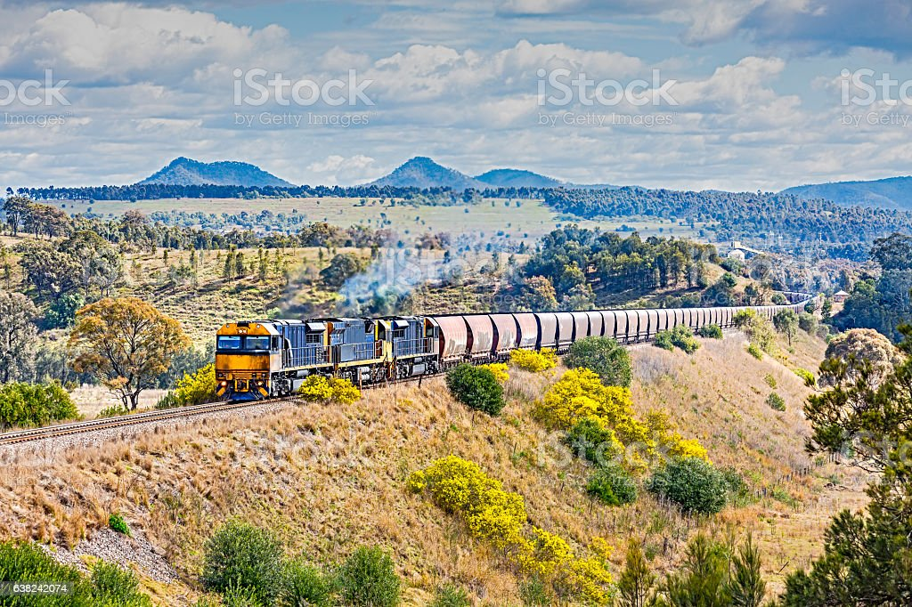 Grimy coal train in scenic, picturesque landscape stock photo