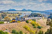 Grimy coal train in scenic, picturesque landscape