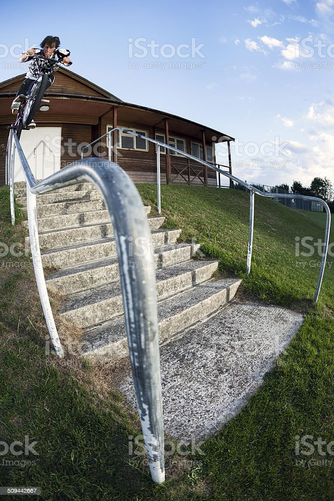grind railing down set of stairs stock photo