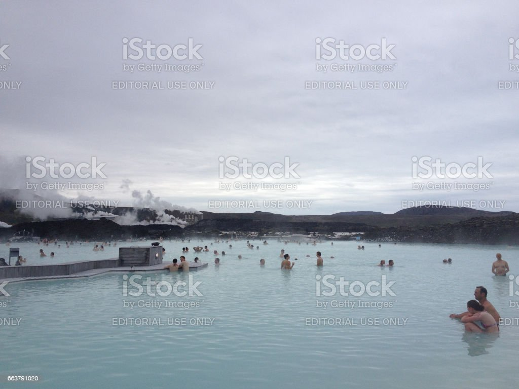 Grindavík, Iceland - 5 July 2015: People swimming and relaxing in the Blue Lagoon, a natural geothermal spa near Reykjavik,, Iceland. Natural mineral water hot springs for healing and relaxing. stock photo