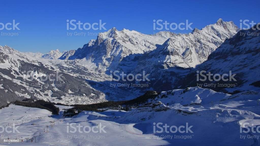 Grindelwald in winter and ski slopes stock photo