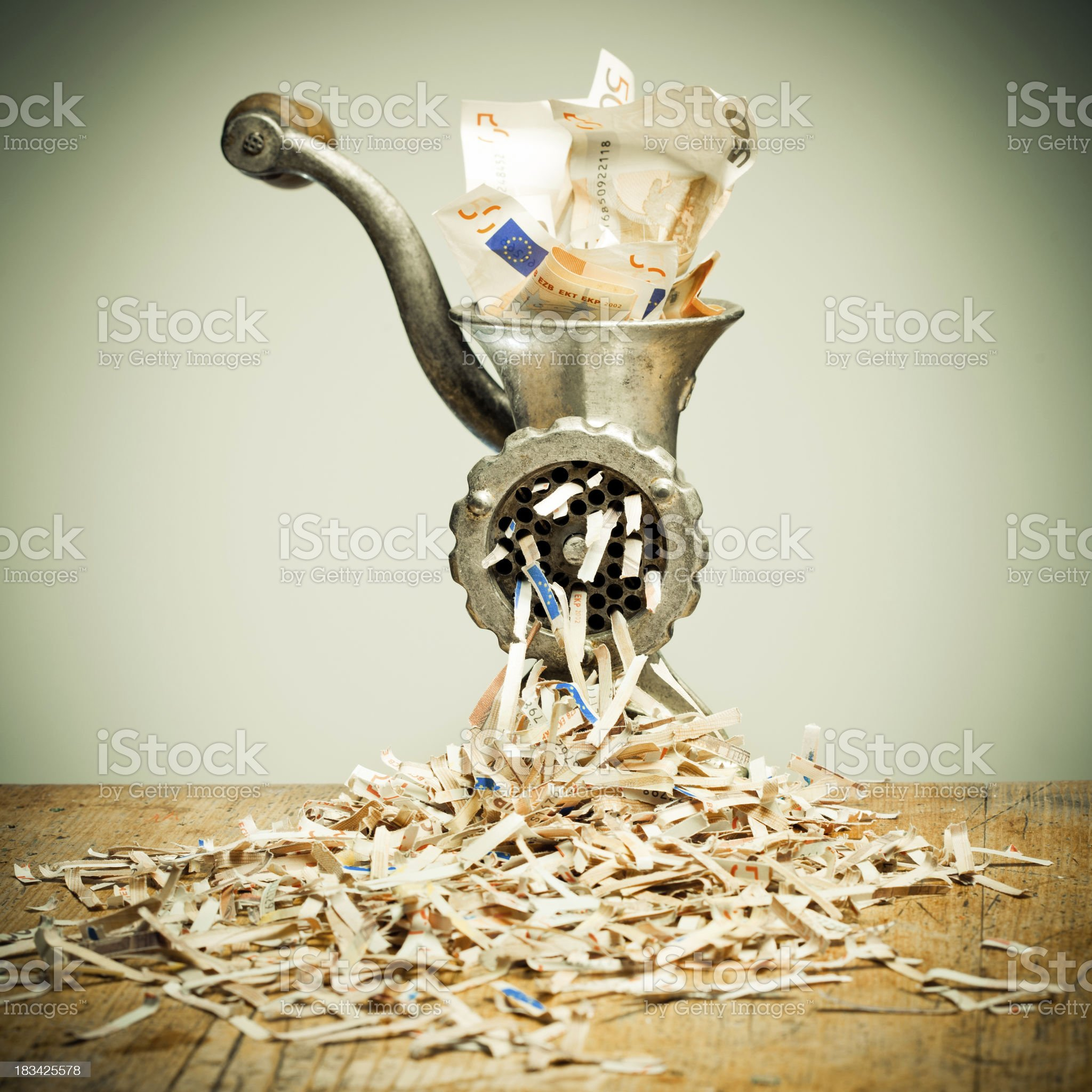 Grinder with Euro notes royalty-free stock photo