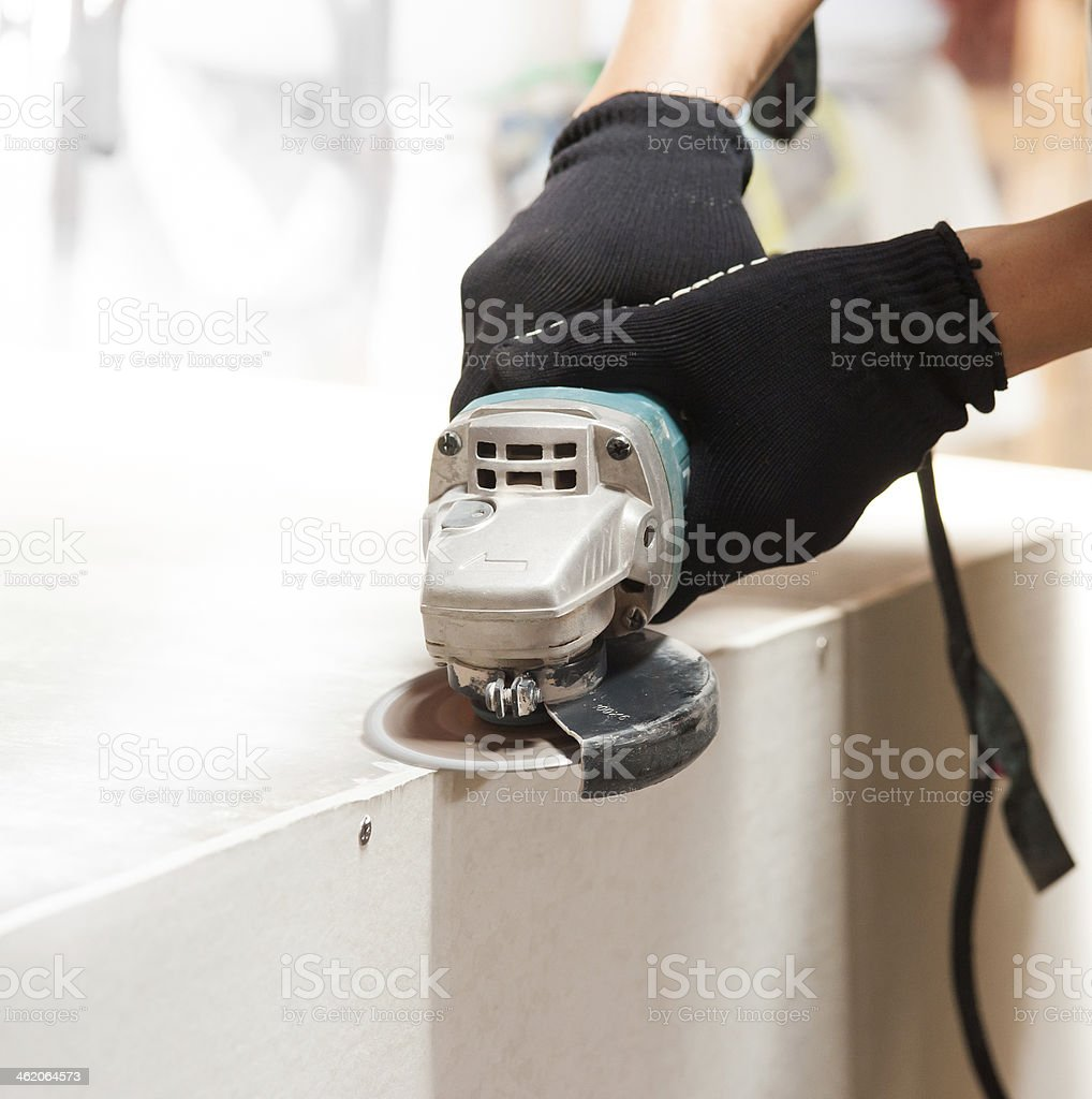 grinder worker cuts stock photo