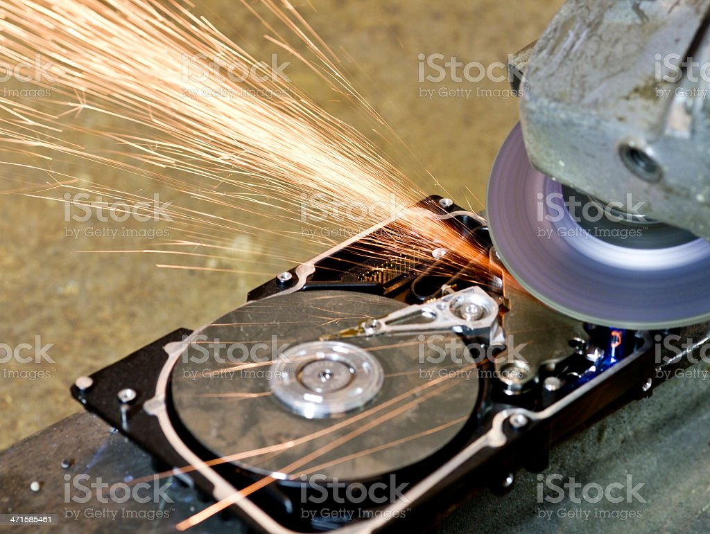 grinder working on open hard drive royalty-free stock photo