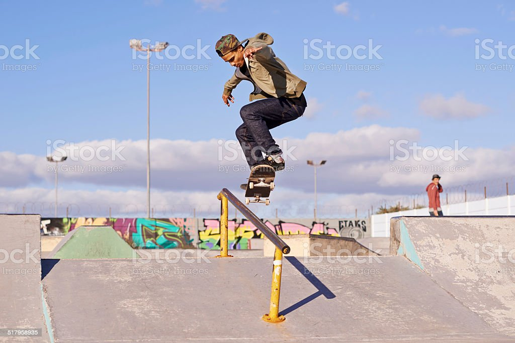 Grinding at the skate park stock photo