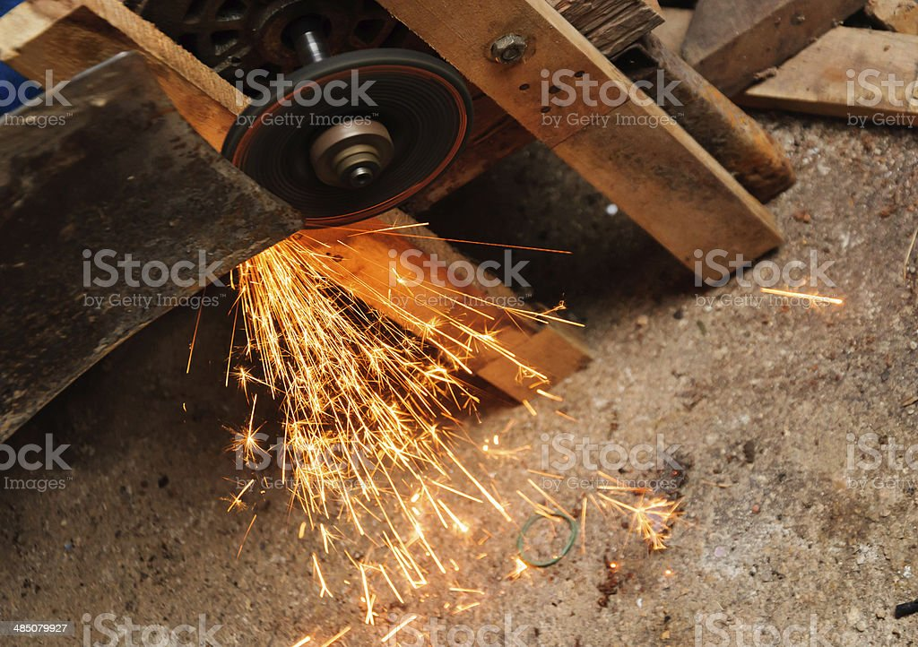 Grinding Blade with flame in factory stock photo