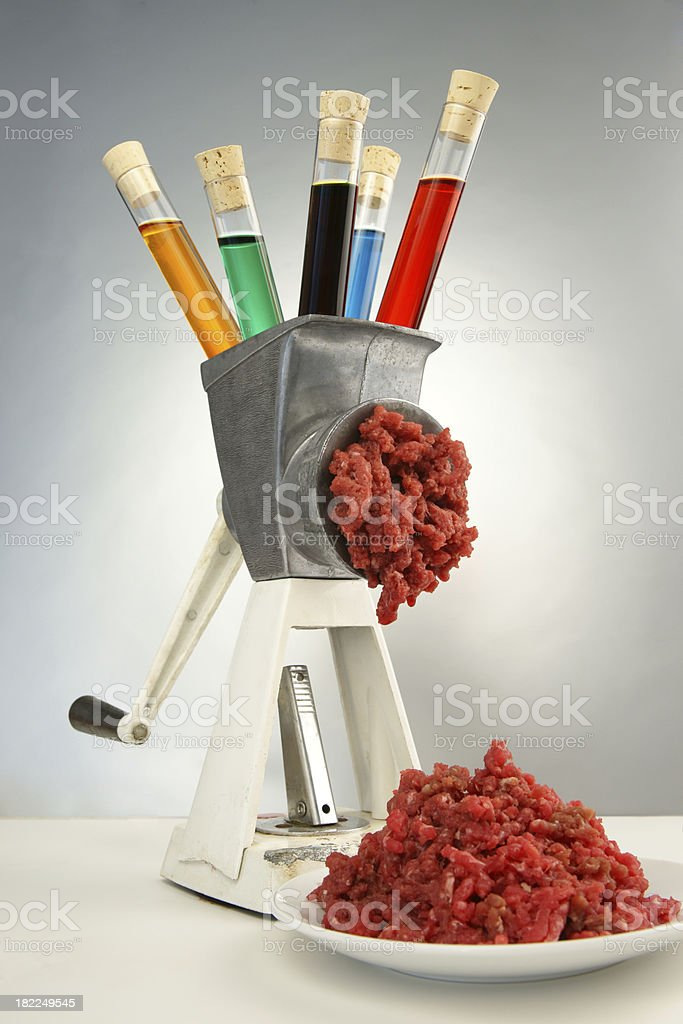 Grinding Chemicals Into Meat royalty-free stock photo