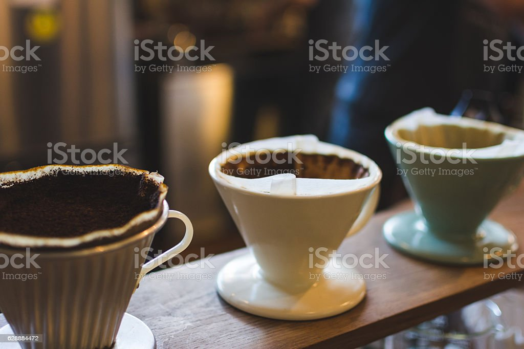 Grinding coffee in a dripper, drip coffee, selective focus. stock photo