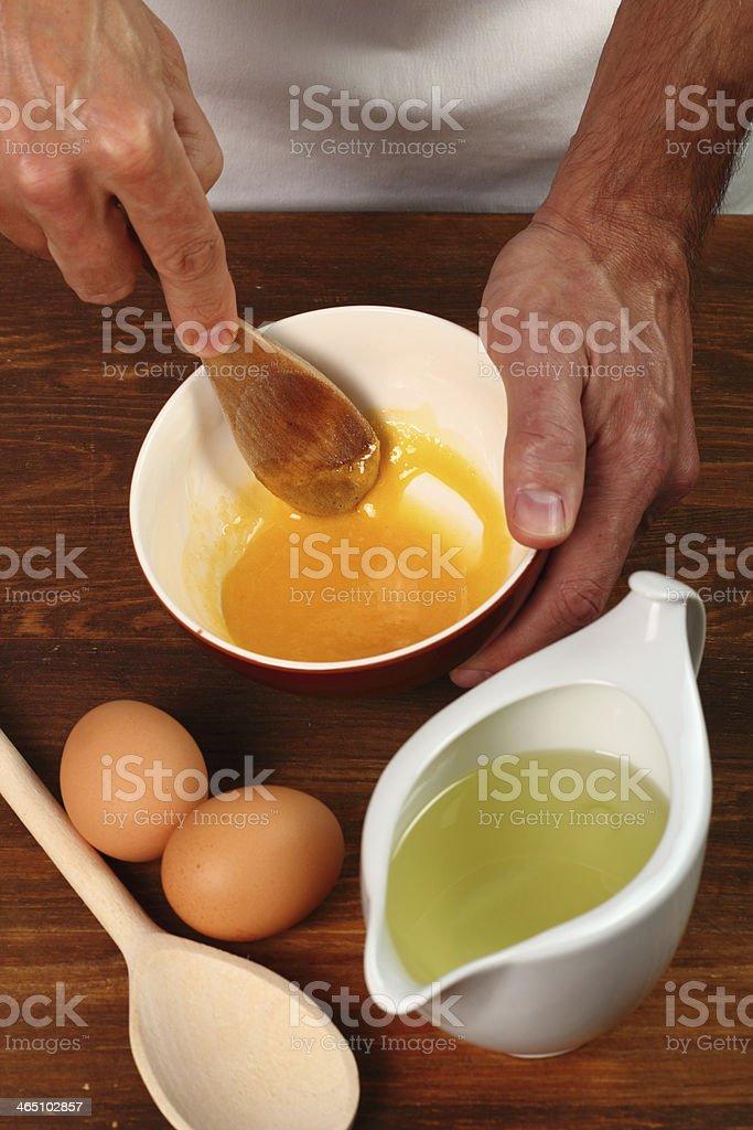 Grinding Egg Yolk with sugar royalty-free stock photo