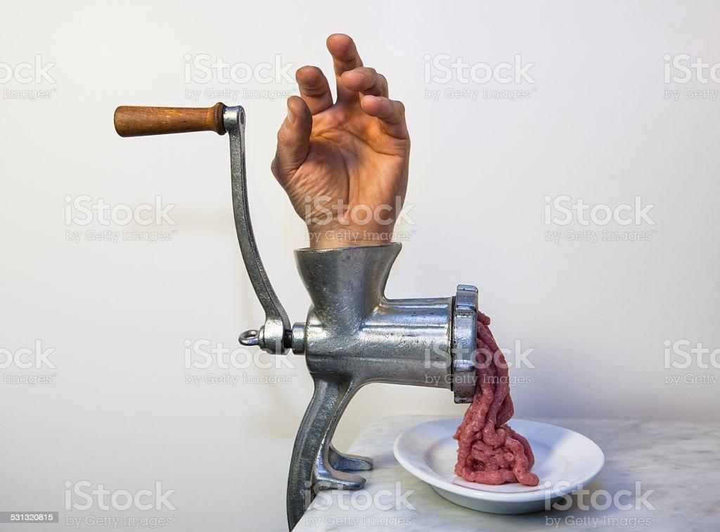 Grinding hand stock photo