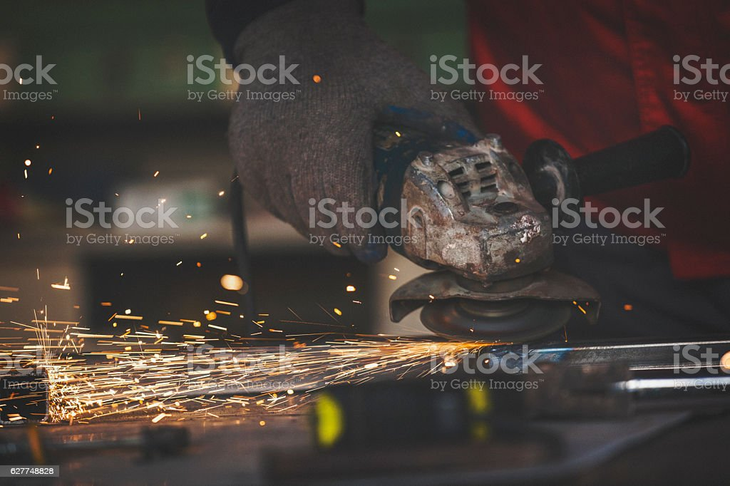 Grinding metal bar close up shot stock photo