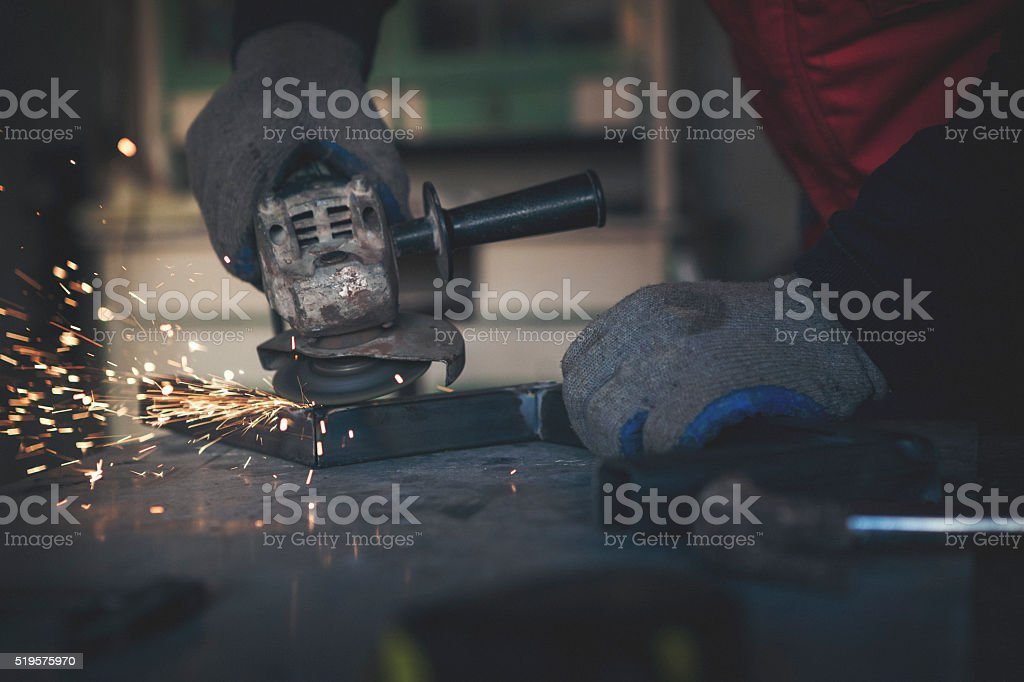 Grinding metal bars close up shot stock photo