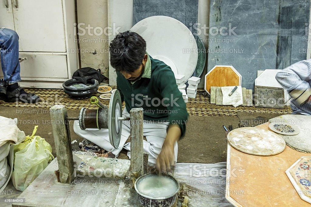 Grinding semi precious stones for intarsia stock photo