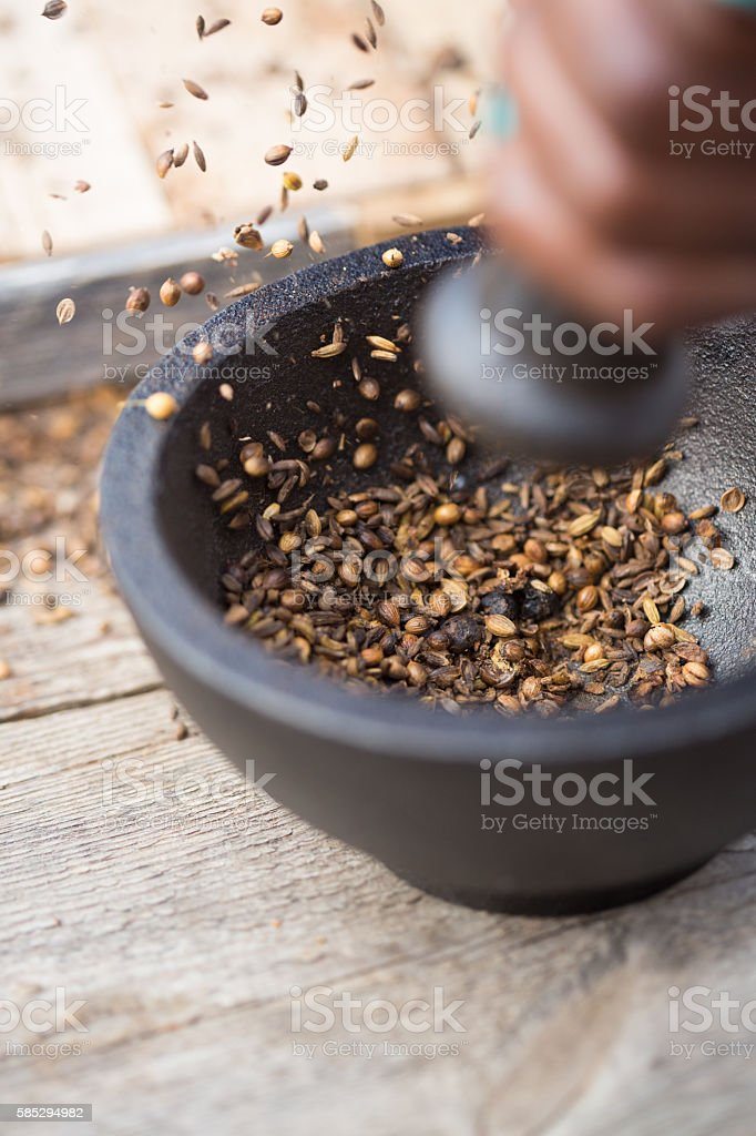 Grinding Spice with Mortar and Pestle stock photo