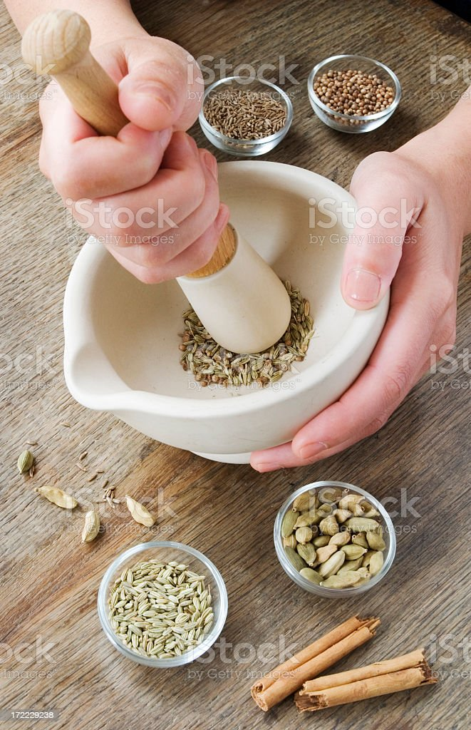 Grinding spices. stock photo