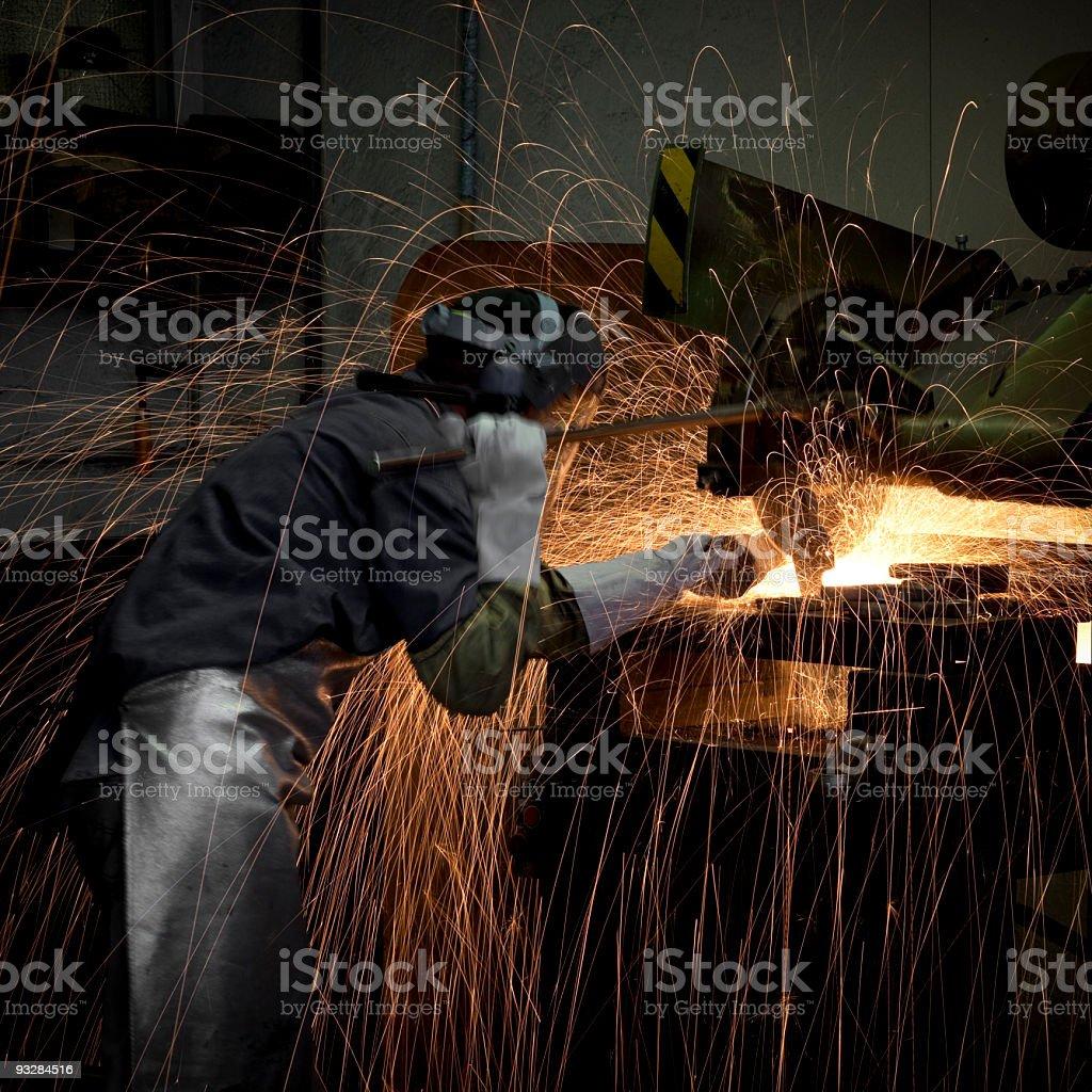 grinding steel worker stock photo
