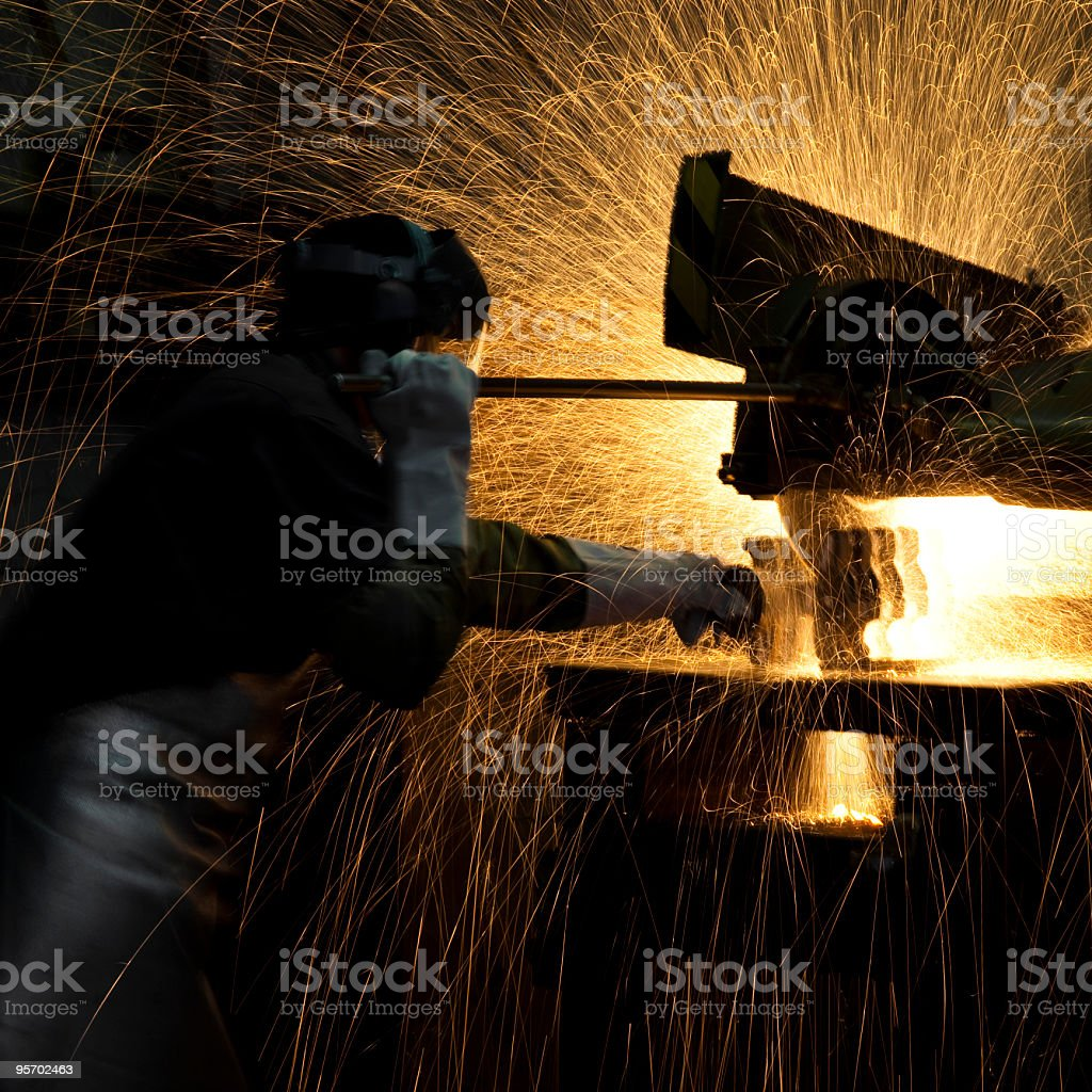 grinding steel worker royalty-free stock photo