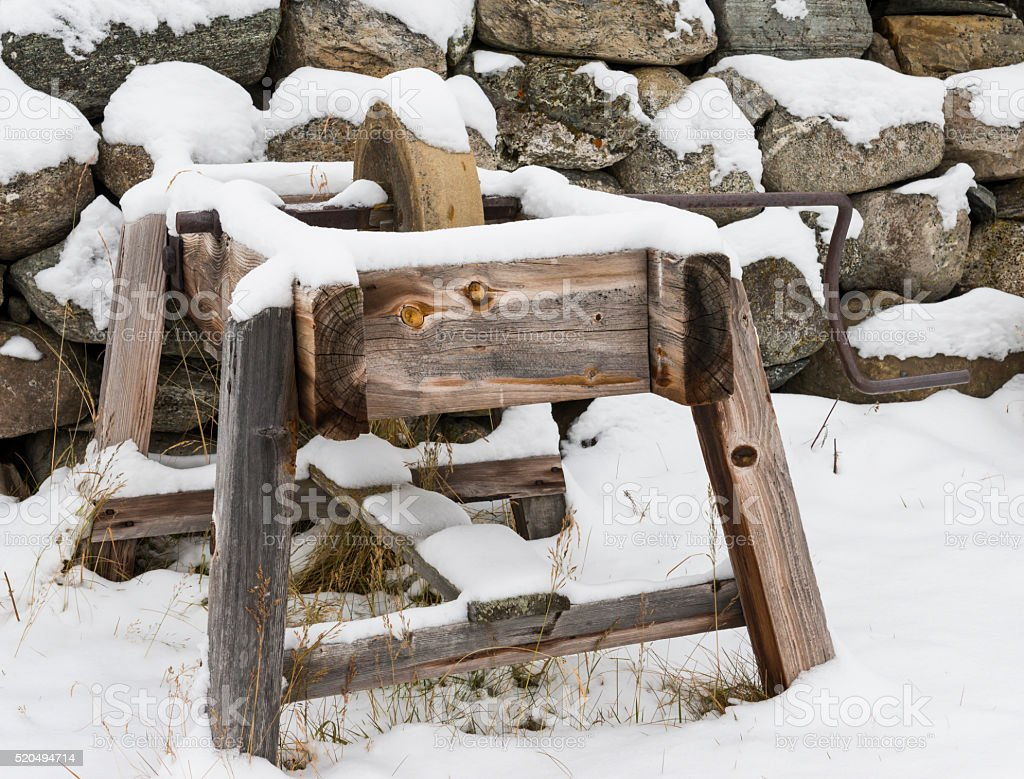 Grinding stone in winter stock photo