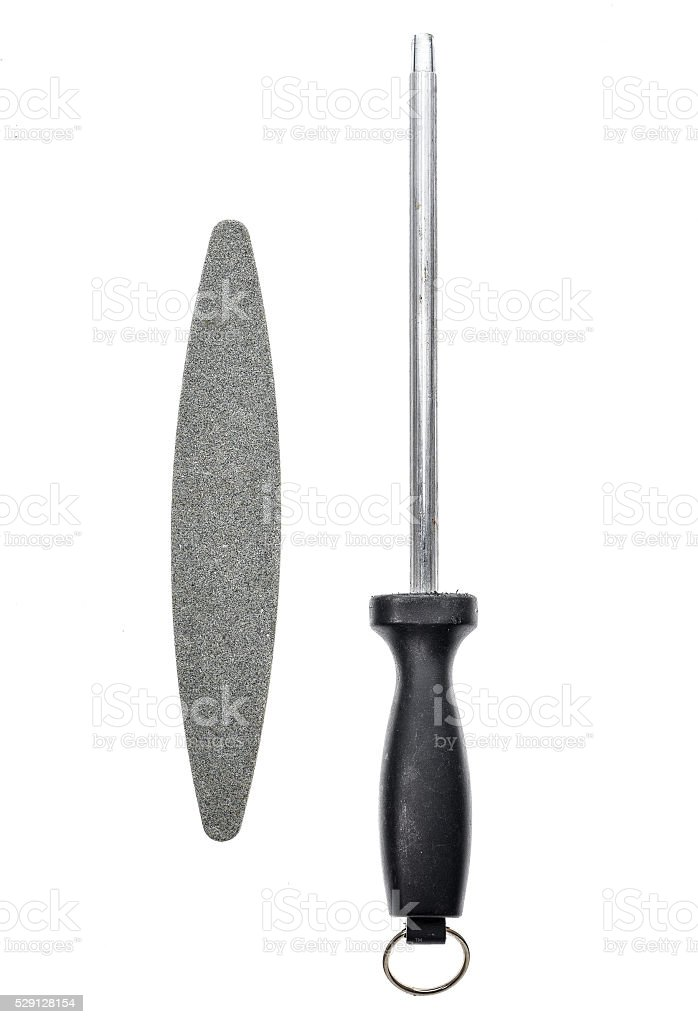 Grindstone or whetstone and sharpener on white background stock photo