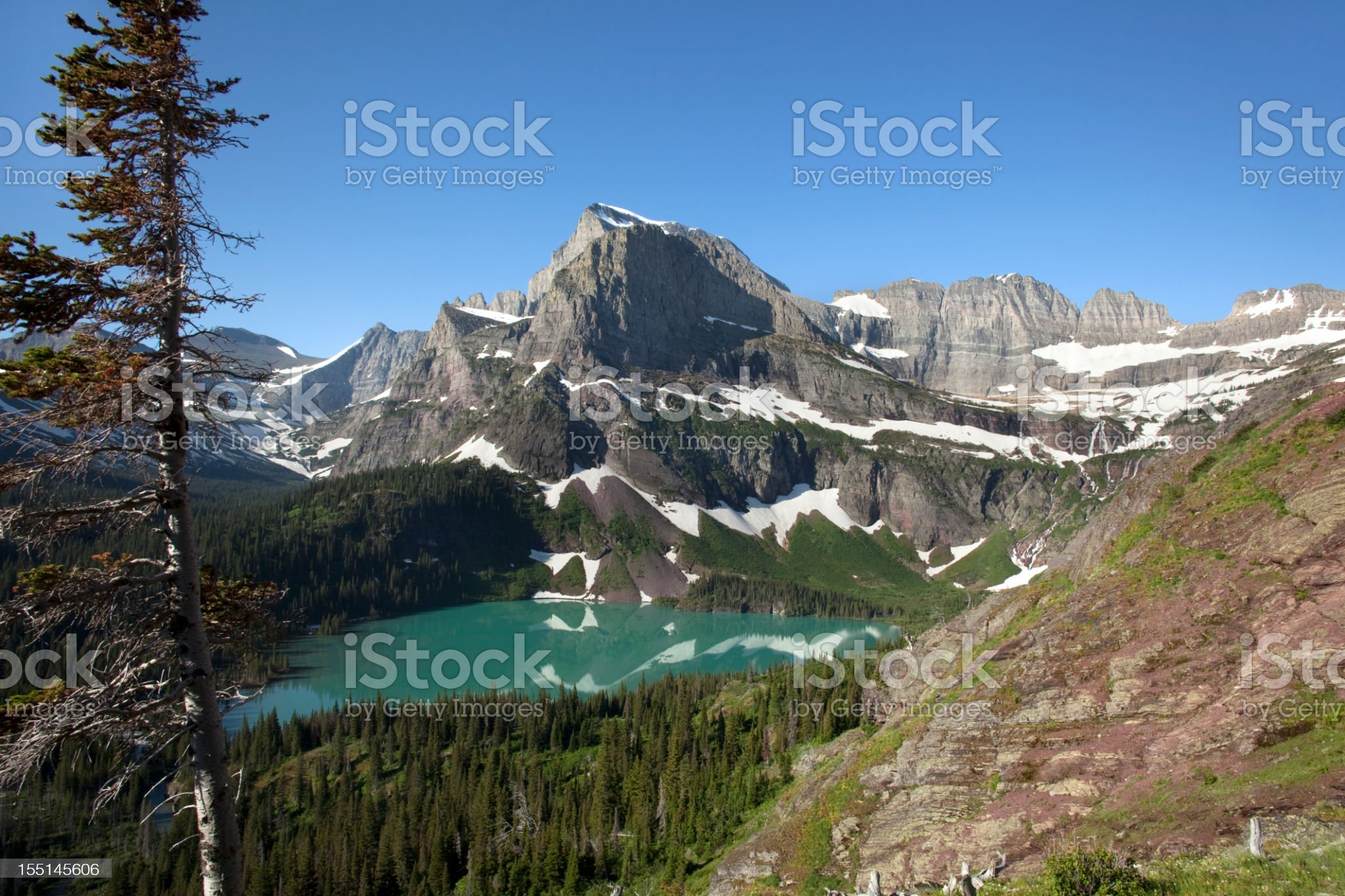 Grinnell Lake and mountains in Glacier National Park Montana horizontal royalty-free stock photo