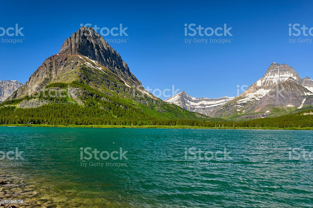 Grinnell Point and Switftcurrent Lake stock photo