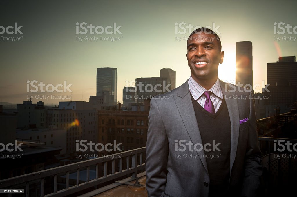 Grinning African American Businessman on Balcony stock photo