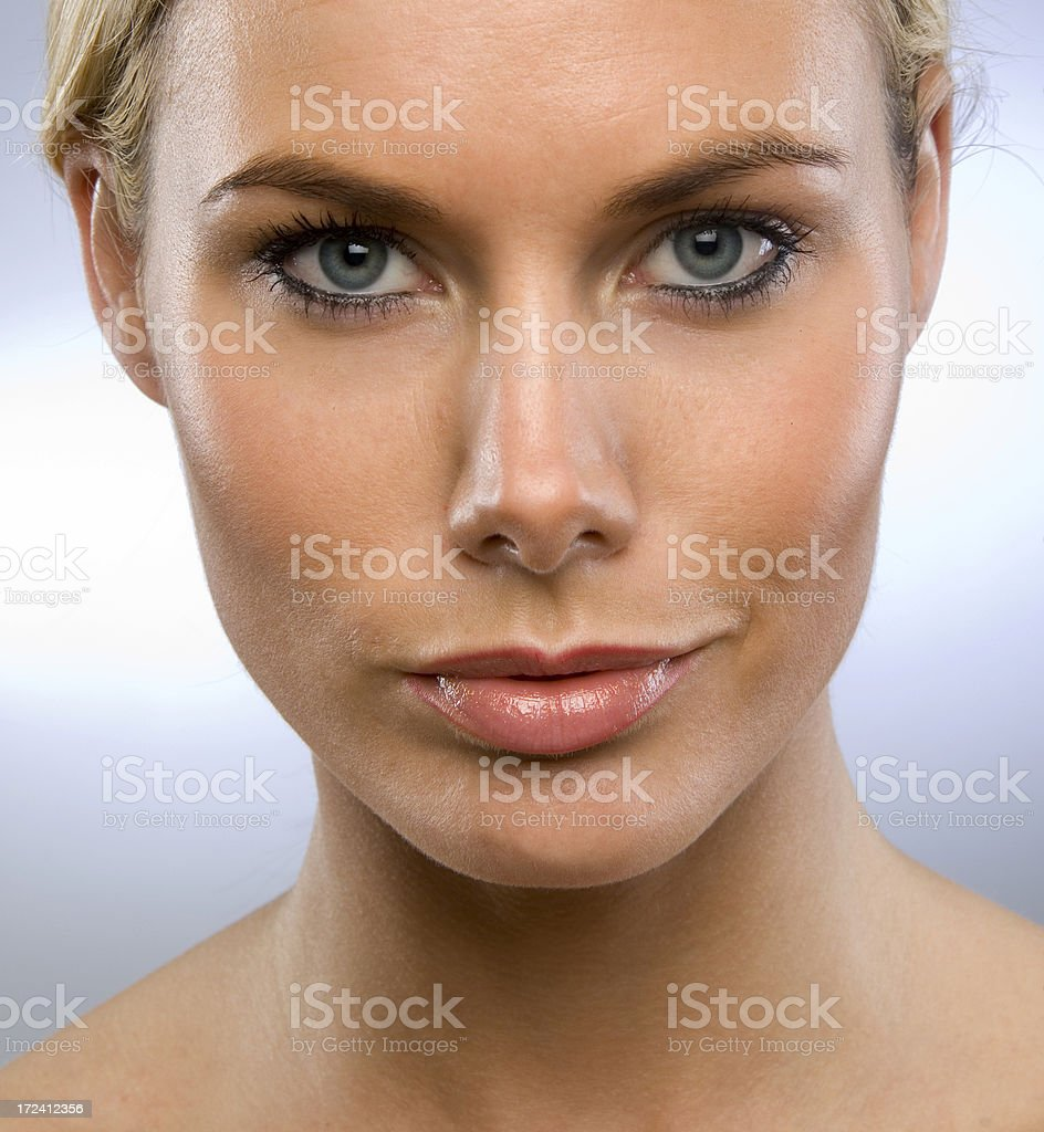 Grinning blond woman royalty-free stock photo