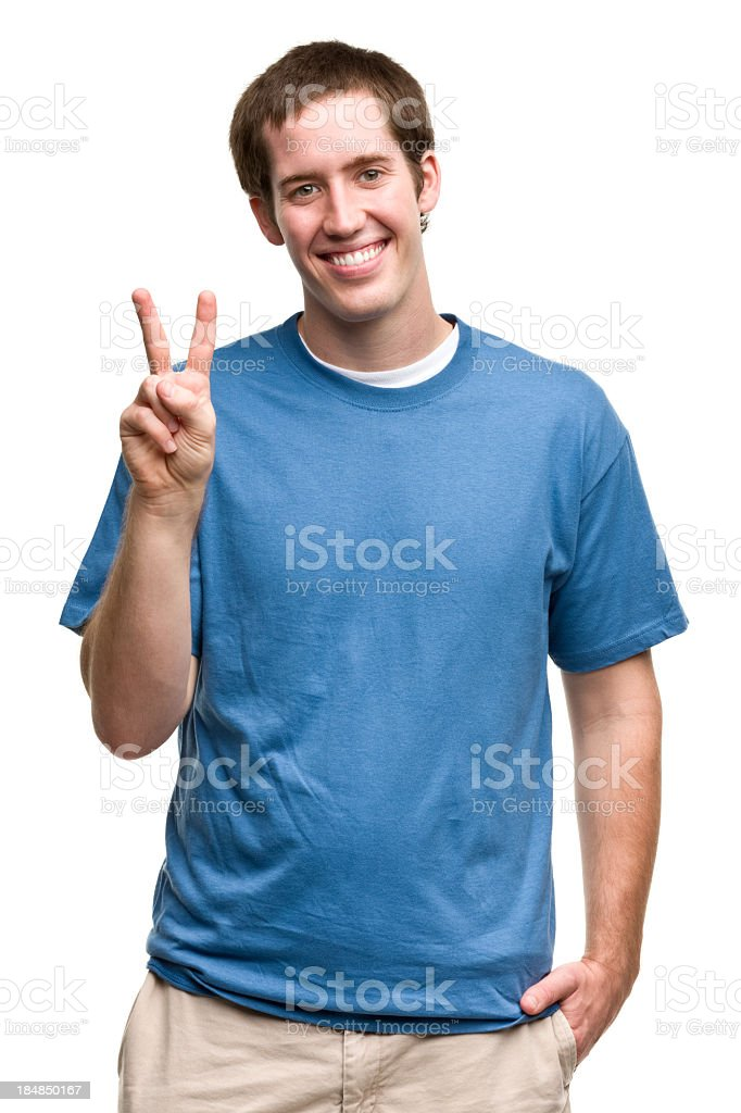 Grinning Young Man Gives Peace Sign stock photo