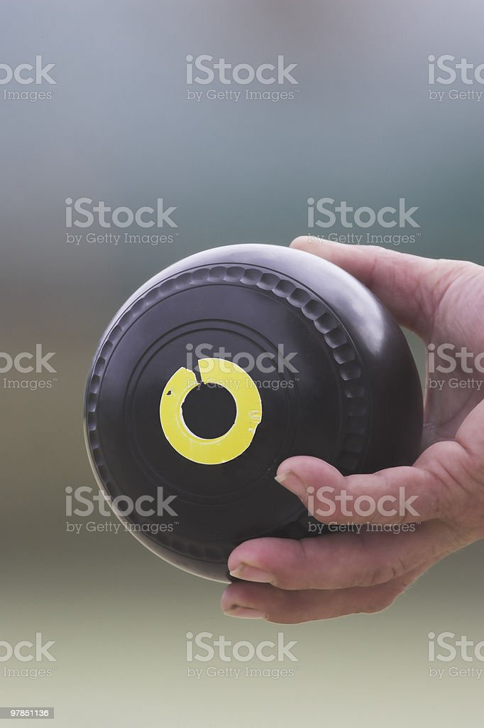Gripping a Lawn Bowl royalty-free stock photo