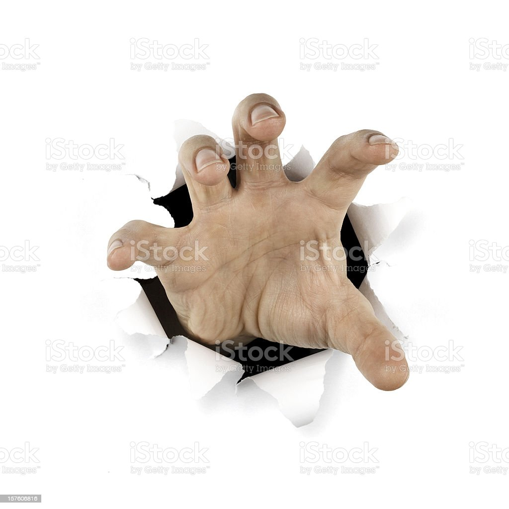 Gripping hand . Reaching Paper Catching Tearing Hole stock photo