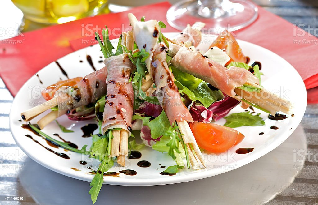 Grissini stick with parma ham royalty-free stock photo